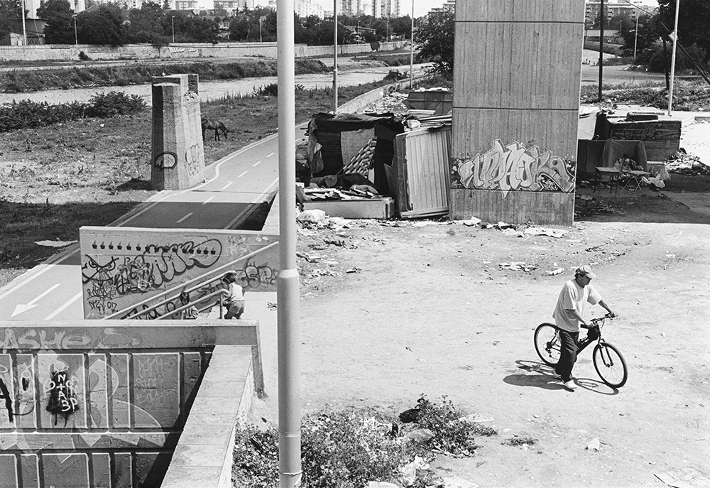 Roma people living under a bridge along the Vardar river. Skopje, North Macedonia, 2012